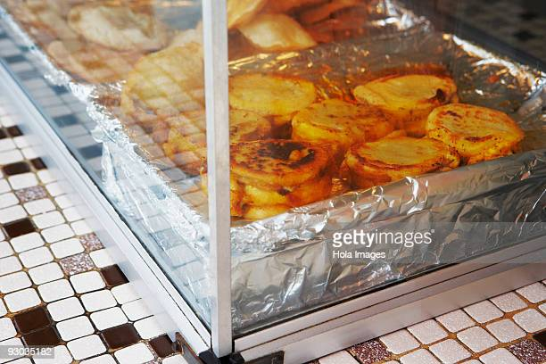 Close-up of arepa rellena food in a display cabinet, Luquillo, Puerto Rico