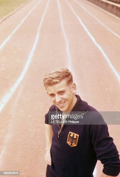 Close-Up Of Armin Hary. Cologne - septembre 1958 - Portrait du coureur Armin HARY en survêtement sur une piste d'athlétisme, souriant.