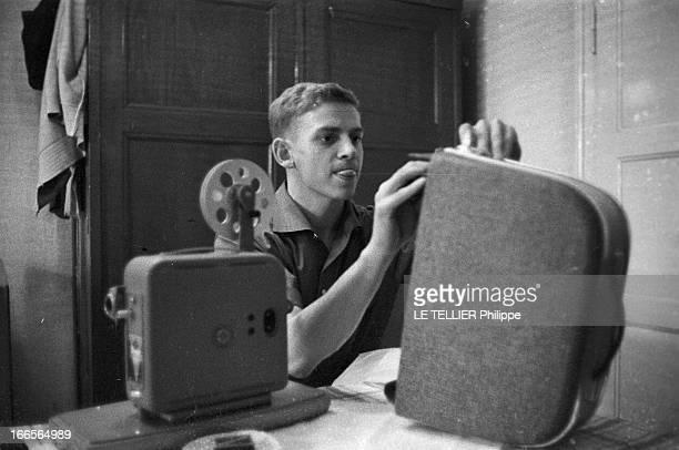Close-Up Of Armin Hary. Cologne - septembre 1958 - Portrait en intérieur de l'athlète Armin HARY dans sa chambre mansardée, installant son projecteur...