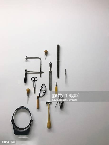 Close-Up Of Arranged Tools Against White Background