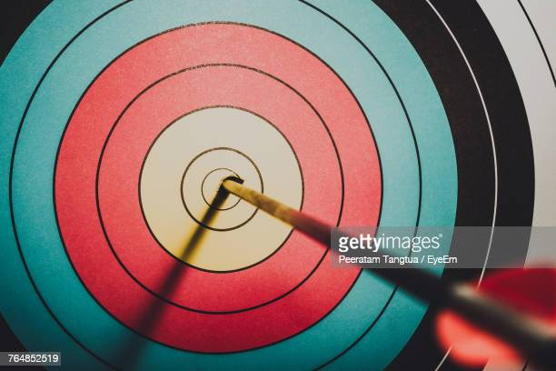 Close-Up Of Arrow On Bulls-Eye