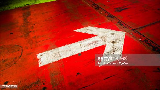 Close-Up Of Arrow Symbol On Road