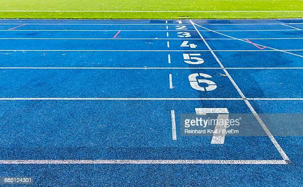 close-up of arrow symbol - track and field stadium stock pictures, royalty-free photos & images
