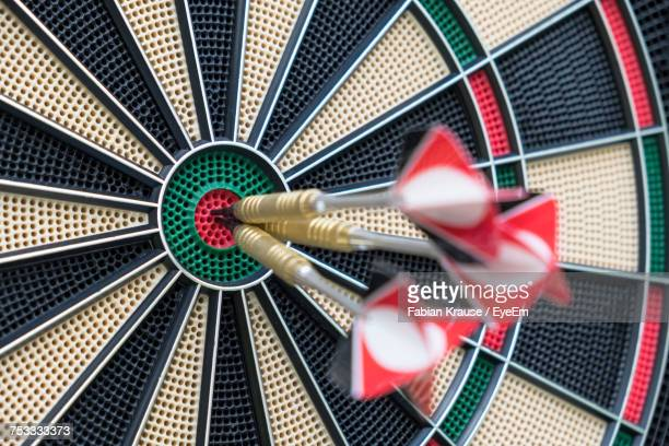 close-up of arrows in dartboard - perfection stock pictures, royalty-free photos & images