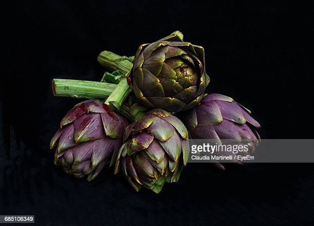 Close-Up Of Artichokes Against Black Background