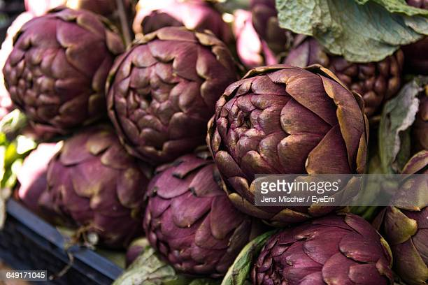 Close-Up Of Artichokes At Market For Sale