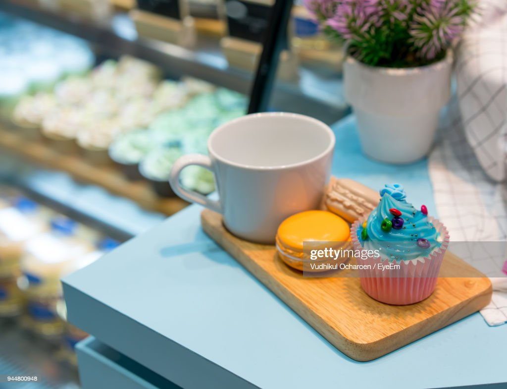 Close-Up Of Artificial Cupcake With Macaroons On Table : Stock Photo