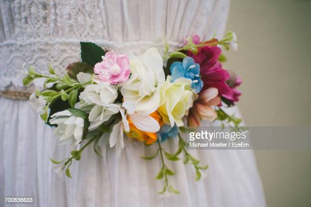 Close-Up Of Artificial Flowers On Wedding Dress