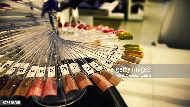 Close-Up Of Artificial Nails With Numbers In Beauty Spa