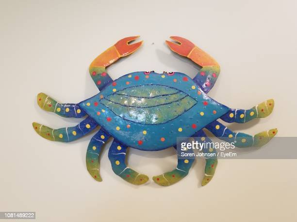 close-up of artificial painted crab on table - soren johnsen stock pictures, royalty-free photos & images