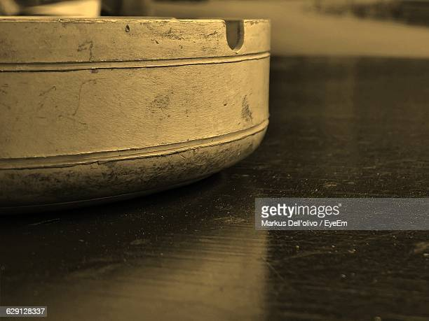 Close-Up Of Ashtray On Table