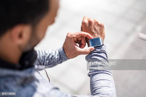 close-up of athlete checking smartwatch - checking sports stock pictures, royalty-free photos & images