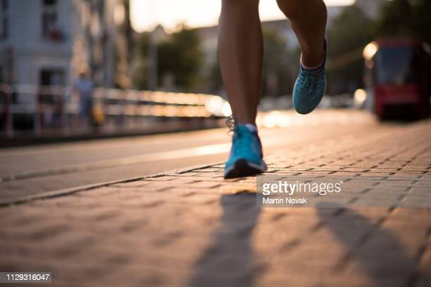 closeup of athlete feet in running shoes - human foot stock pictures, royalty-free photos & images