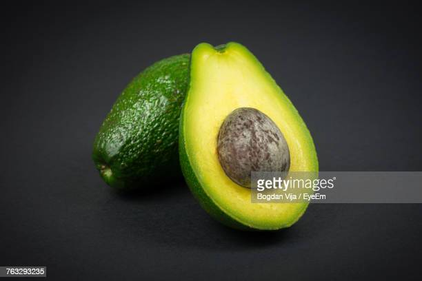 Close-Up Of Avocado Against Black Background