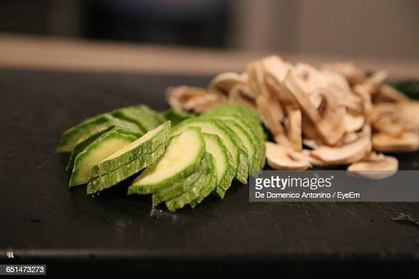 Close-Up Of Avocado And Mushroom Slices On Table