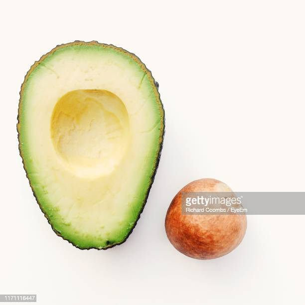 close-up of avocado slice against white background - avocado stock pictures, royalty-free photos & images