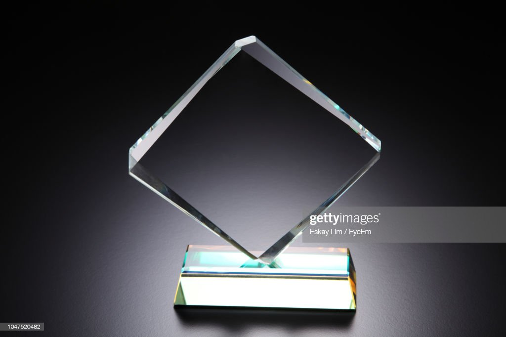 Close-Up Of Award Over Black Background : Stock Photo
