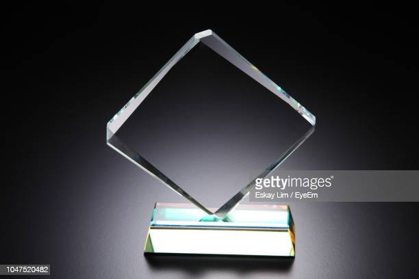 close-up of award over black background - award stock pictures, royalty-free photos & images