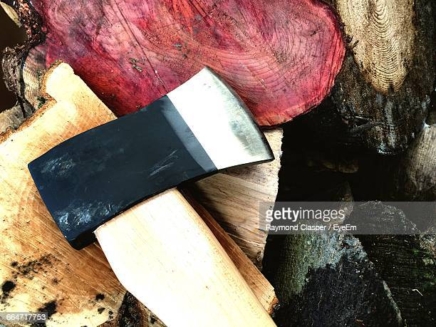 Close-Up Of Axe On Chopped Wood