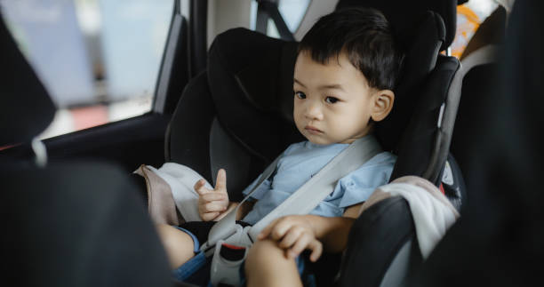 Close-Up Of Baby Boy Sitting In Car