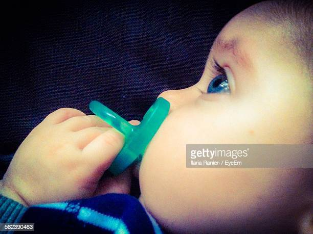 Close-Up Of Baby Boy With Pacifier