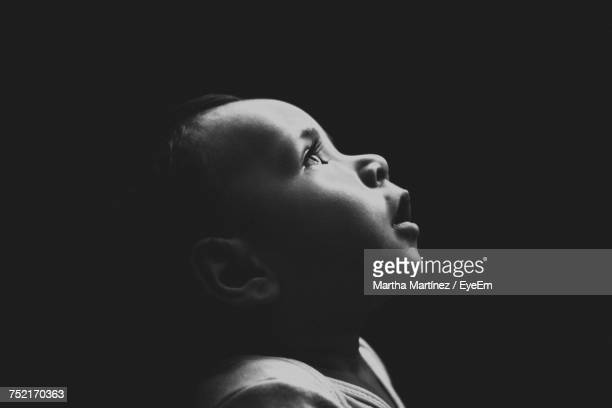 close-up of baby girl against black background - mexico black and white stock pictures, royalty-free photos & images