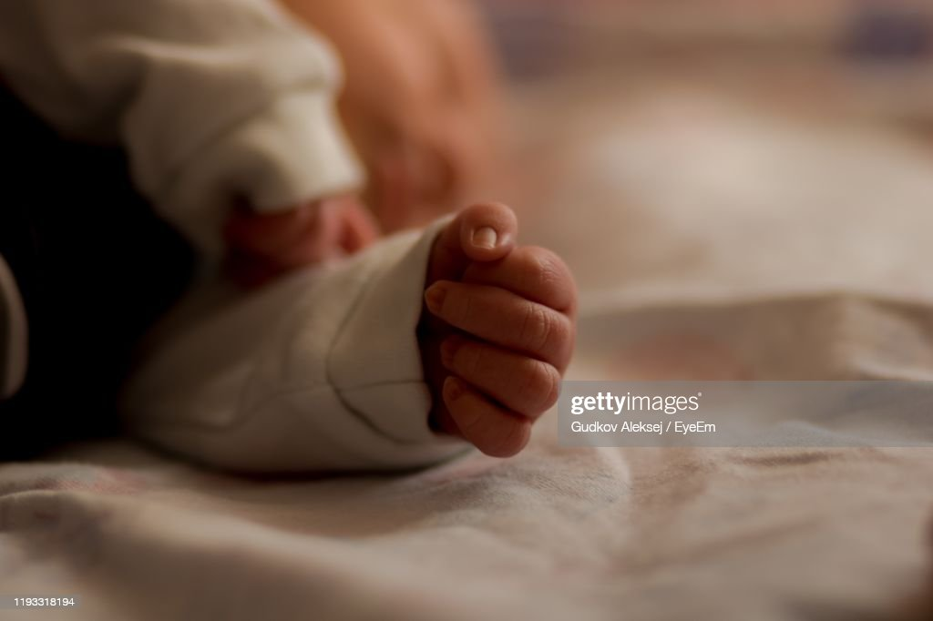 Close-Up Of Baby Sleeping On Bed : Stock Photo