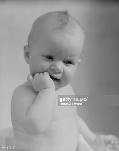 close-up of baby with finger in mouth - number of people stock pictures, royalty-free photos & images