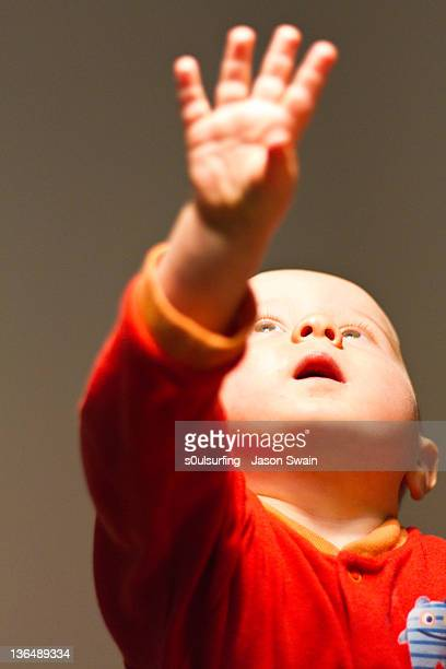 closeup of baby with red shirt - s0ulsurfing fotografías e imágenes de stock