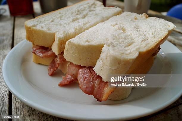 Close-Up Of Bacon Sandwich In Plate On Table