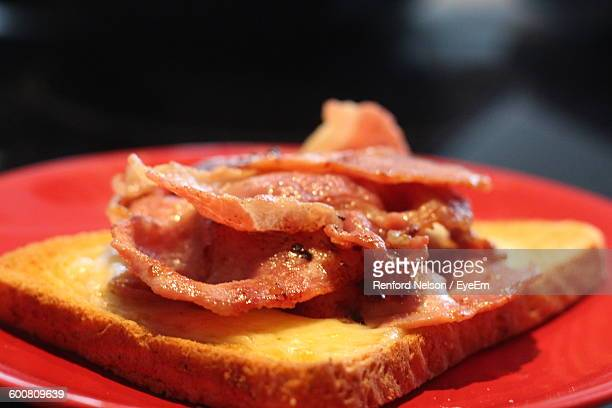 Close-Up Of Bacon Sandwich On Plate