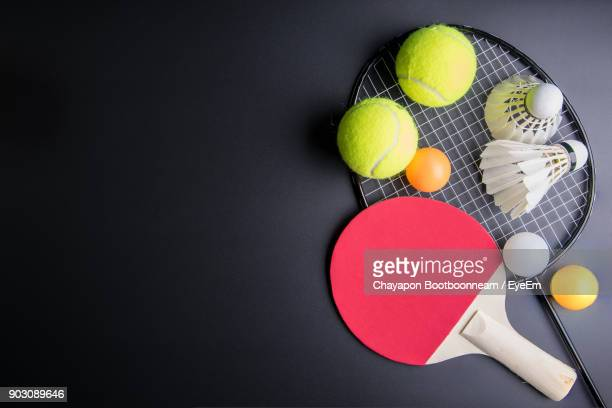 close-up of badminton and shuttlecock on table - sports equipment stock pictures, royalty-free photos & images