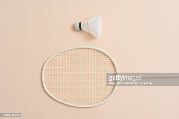 close-up of badminton and shuttlecock over colored background - beige background stock pictures, royalty-free photos & images