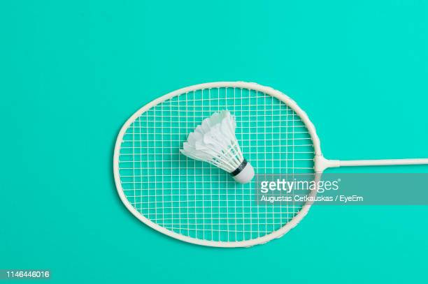 close-up of badminton and shuttlecock over colored background - badminton sport stock photos and pictures