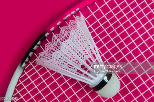 close-up of badminton racket with shuttlecock against colored background - volant de badminton photos et images de collection