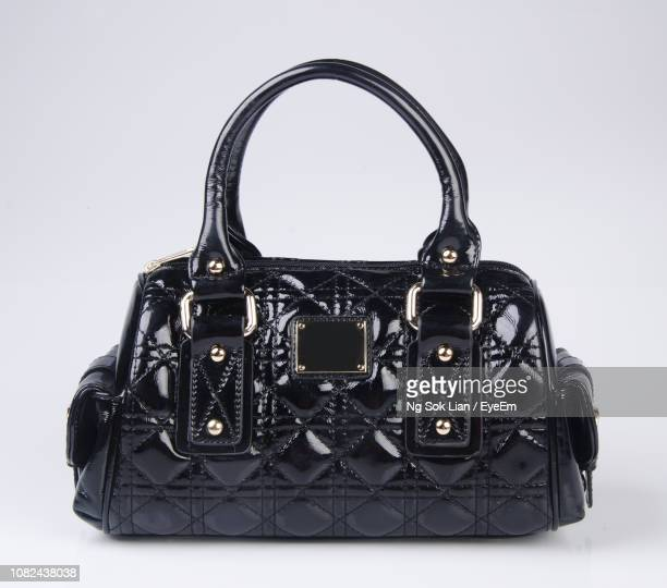 close-up of bag against white background - black purse stock photos and pictures