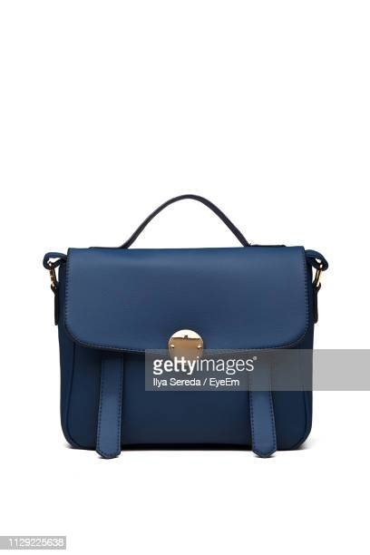 close-up of bag against white background - borsetta da sera foto e immagini stock