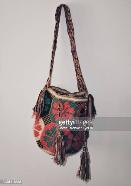 close-up of bag hanging against wall - strap stock photos and pictures