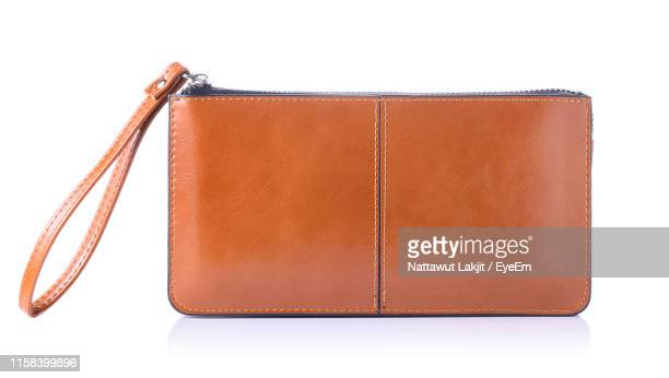 close-up of bag over white background - borsetta da sera foto e immagini stock