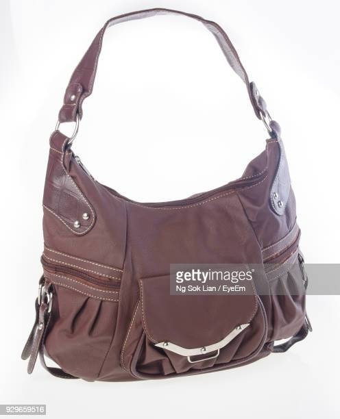 close-up of bag over white background - strap stock photos and pictures