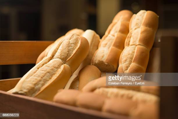 Close-Up Of Baguettes In Crate For Sale At Bakery