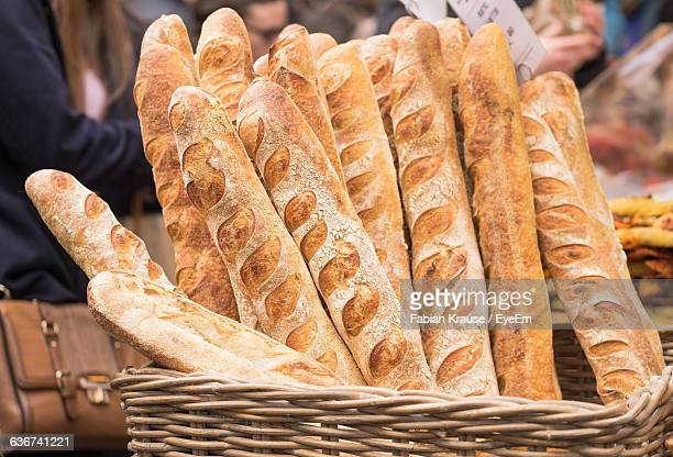 close-up of baguettes in whicker basket - baguette stock pictures, royalty-free photos & images