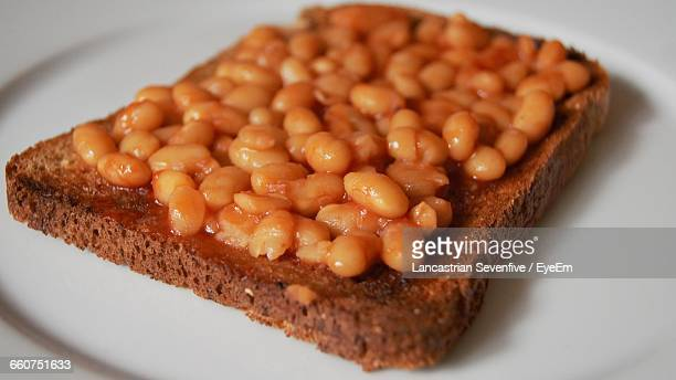 Close-Up Of Baked Beans On Toasted Bread In Plate