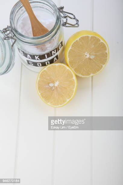 Close-Up Of Baking Soda With Lemons On Table
