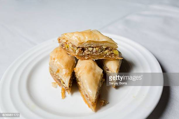 Close-up of Baklava, a dessert made with filo pastry and chopped nuts and sugar syrup.It is a popular turkish dessert