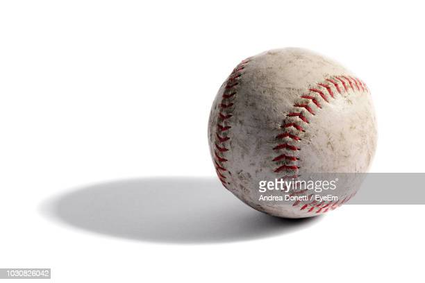close-up of ball against white background - baseball ball stock pictures, royalty-free photos & images
