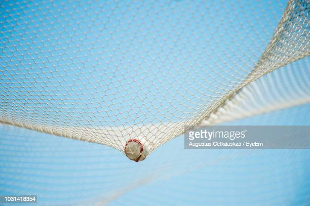 close-up of ball in net against sky on court - 網状 ストックフォトと画像