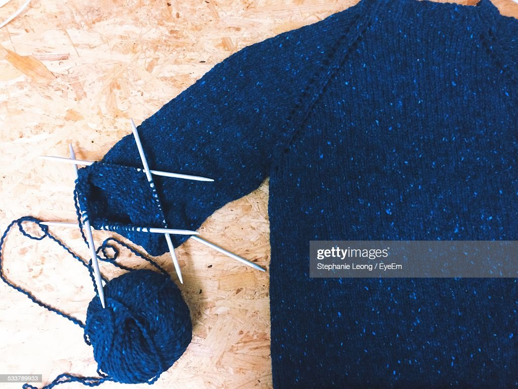 Close-Up Of Ball Of Wool With Knitting Needles And Sweater : Stock Photo