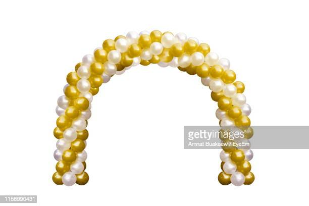 close-up of balloon decoration on white background - arch stock pictures, royalty-free photos & images