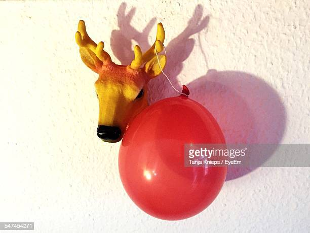 Close-Up Of Balloon Hanging On Artificial Mounted Deer Head
